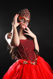 Girl in the mask. Girl in a carnival mask and luxurious dress Stock Photos