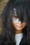 Girl with mask Stock Photography
