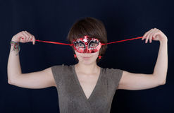 Girl in a mask Royalty Free Stock Photography