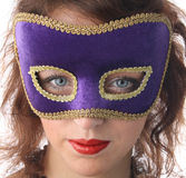 Girl in a mask. The girl in a mask on a white background Stock Photography