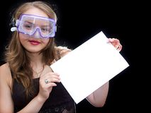 Girl in mask. Hold a sheet of paper Royalty Free Stock Photos