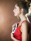 Girl with mask. Elegant girl with a mask like playing a role in theatre royalty free stock photo