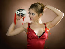 Girl with mask. Elegant girl with a mask like playing a role in theatre stock images