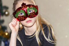 The girl in the mask royalty free stock photos