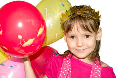 Girl in a mask with balloons Royalty Free Stock Photo