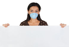 Girl with mask and blank poster Royalty Free Stock Images