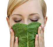 Girl with a mask of cabbage leaf Royalty Free Stock Image