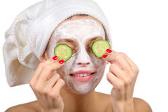 Girl with a mask and cucumber Royalty Free Stock Image
