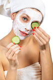Girl with a mask and cucumber Royalty Free Stock Photo