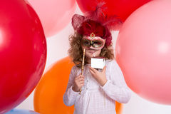 Girl in a mask drinking a beverage out of the box without inscri Stock Images