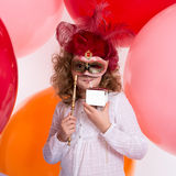 Girl in a mask drinking a beverage out of the box without inscri Stock Photography