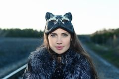 Girl in the mask and fur stock images