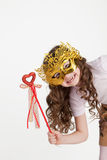 Girl in a mask and a magic wand Stock Photos