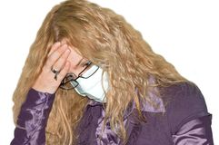 Girl in mask. Pig flue. Headache Royalty Free Stock Photography
