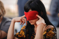 Girl in mask playing mafia game Royalty Free Stock Photography