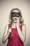 Girl with a mask Stock Image