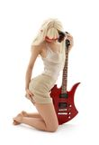 Girl in mask with red guitar. Over white royalty free stock photo