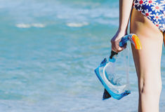 Girl with mask and snorkel diving Stock Images