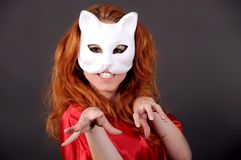 Girl in mask. Girl in a white mask depicting a cat royalty free stock photos