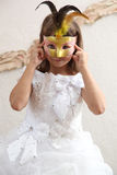 A girl in a mask Royalty Free Stock Photography
