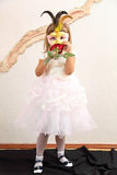 A girl in a mask Stock Photography