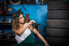 Job in the service station. The girl in the mask working at the bench. Hard work for women. Master welder, Working profession. Where to go to study. Work stock photo