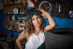 Job in the service station. The girl in the mask working at the bench. Hard work for women. Master welder, Working profession. Where to go to study. Work royalty free stock photo