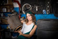 Job in the service station. The girl in the mask working at the bench. Hard work for women. Master welder, Working profession. Where to go to study. Work stock photography