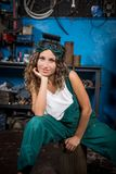 Job in the service station. The girl in the mask working at the bench. Hard work for women. Master welder, Working profession. Where to go to study. Work royalty free stock photos