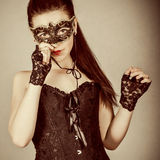 girl in masquerade mask Stock Image