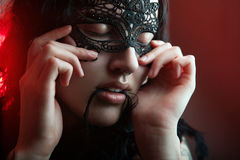 Girl in masquerade mask Royalty Free Stock Images