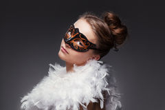 Girl in masquerade mask Stock Photography