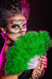 Girl in masquerade mask Stock Images
