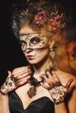 Girl in masquerade mask Stock Photo