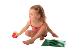 Girl with a massage carpet. Stock Images