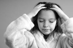 Girl massaging hair royalty free stock images