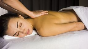 Girl gets back massage royalty free stock photo