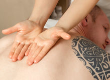 Girl masseuse doing massage Royalty Free Stock Photography