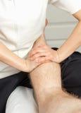 Girl masseuse doing massage royalty free stock image