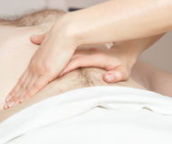 Girl masseuse doing massage Royalty Free Stock Images