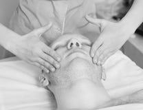 Girl masseuse doing massage Stock Photography