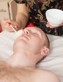 Girl masseuse doing massage Royalty Free Stock Photos