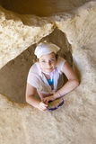 Girl at Matala caves Stock Photography