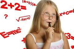 The girl and mathematical formulas. It is isolated on a white background Royalty Free Stock Images