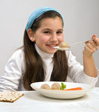 Girl matzo ball soup. Jewish girl eating a matzo ball soup in passover Stock Photos