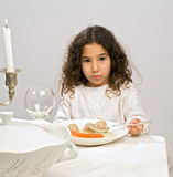 Girl matzo ball soup. Jwish girl eating a matzo ball soup in passover Royalty Free Stock Image
