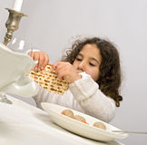 Girl matzo ball soup. Jewish girl eating a matzo ball soup in passover Stock Image