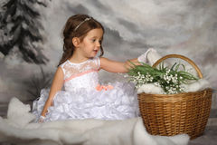 Girl with may-lilies Royalty Free Stock Photos