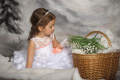 Girl with may-lilies Royalty Free Stock Images