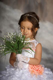 Girl with may-lilies Royalty Free Stock Photography